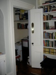Bookcase to left of FP with home-made bi-fold door to filing area