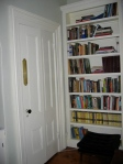 Bookcase to left of FP with closet door closed